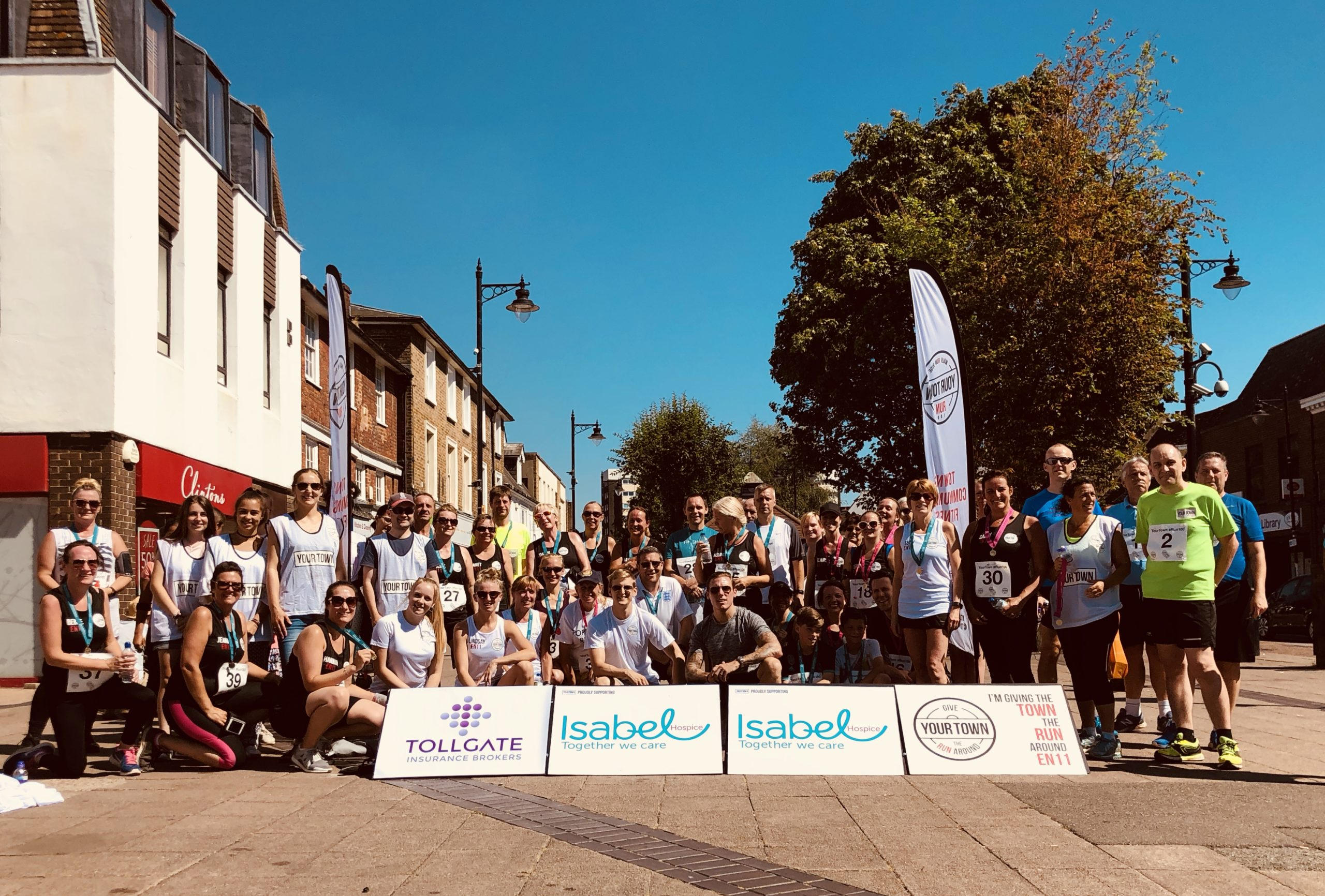 Image shows a group of runners who have just finished a 5km Get-Together run with Your Town CIC, supporting Isabel Hospice.